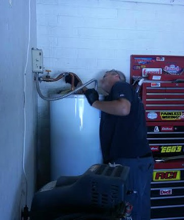 Lucas fixing the hot water heater